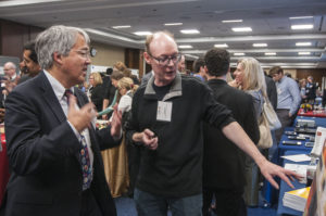 Laurent Itti, left, explains his research to Jim Kurose, Assistant Director of CISE at NSF.